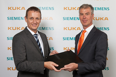 Dr. Robert Neuhauser, CEO of Business Unit Motion Control Systems at Siemens (left) and Manfred Gundel, CEO of KUKA Roboter GmbH